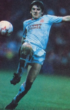 Featured Peter Beardsley wearing the grey away kit of season 1987-1988 with the red Crownpaints sponsor.