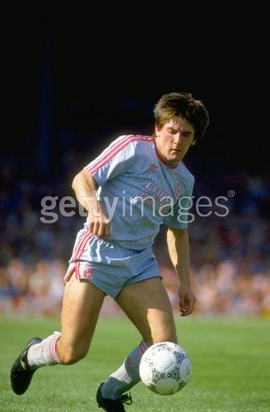 Another picture showing Peter Beardsley wearing a grey away kit with the white Crownpaints sponsor.